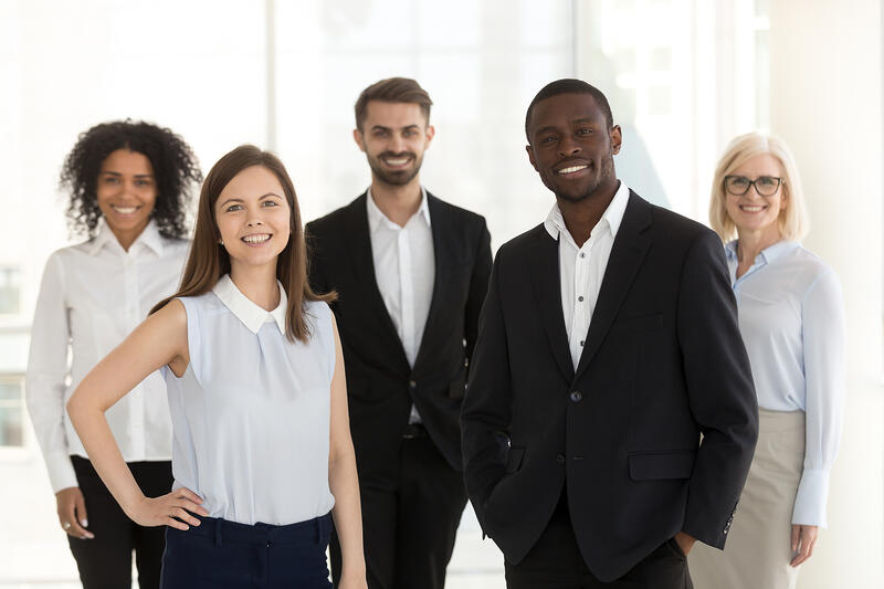 A diverse team of happy real estate agents